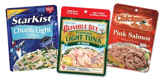 A pouch of Starkist tuna, Bumble Bee tuna, and Chicken of the Sea pink salmon.