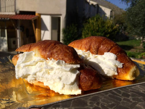 Two croissants filled with cream in Italy.