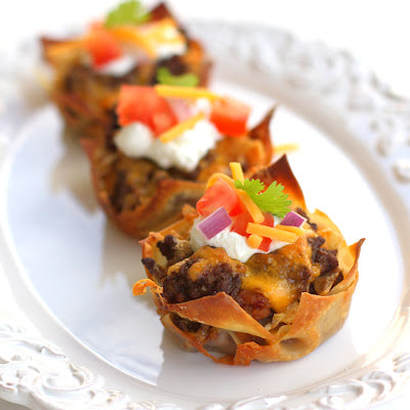 A plate of double decker taco cupcakes, a great appetizer or finger food.