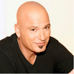 Howie Mandel with a soul patch, a look he is known for.