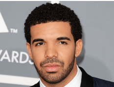 Drake with stubble, a look he often wears.