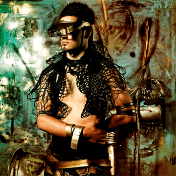 A steampunk man wearing numerous steampunk accessories.