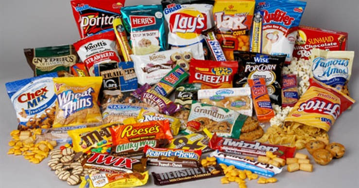 A picture of Twix, Reese's, Lay's, and other junk foods.