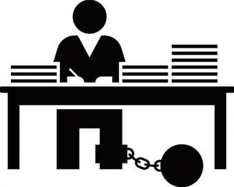 An illustration of a person chained to their desk.